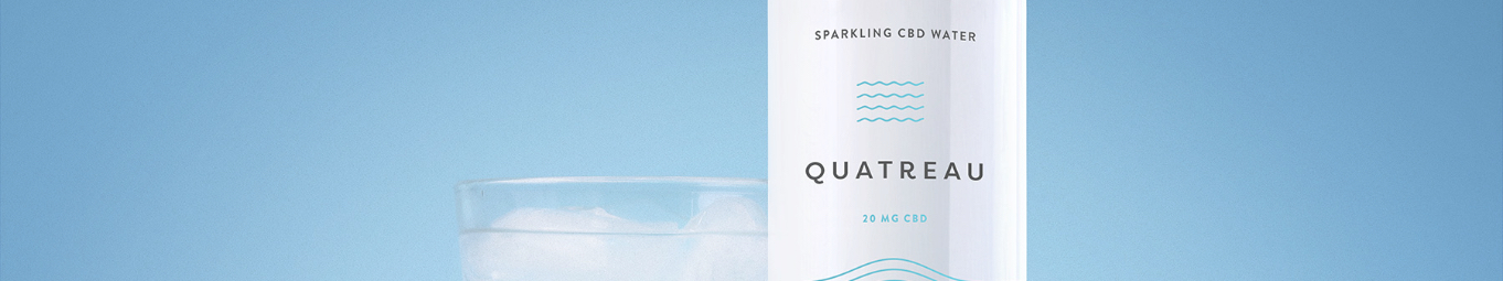 Can of Quareau next to a glass of ice